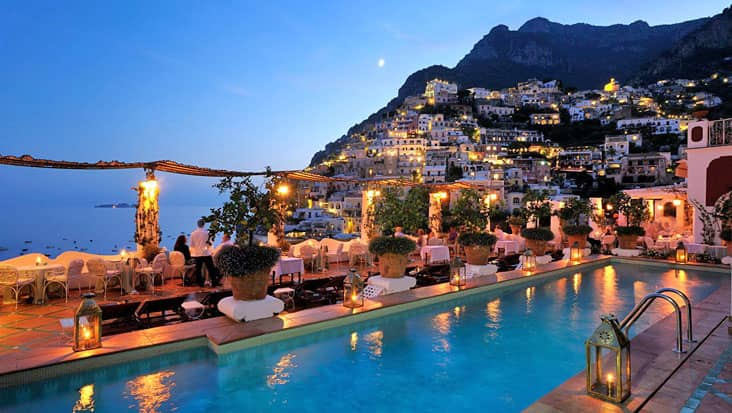 Positano by night, from the pool of the Hotel Le Sirenuse
